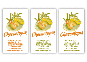 Cheesetopia/biz cards — logo design for cheese shop with artisanal cheese board and olive oils